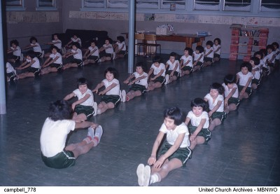 Norway House School, opened at the turn of the century was closed in 1967. Here girls demonstrate their flexibility for the camera in a 1962 gym class. UCArchivesWpg campbell 778
