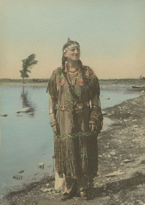 Deaconess Viola Daly worked with Aboriginal people from 1932 when she graduated from the Deaconess program at Manitoba College until her retirement in 1964.  Here she is in regalia belonging to her landlady on the Caughnawaga Reserve. UCCArchivesWpg Daly fonds