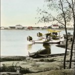Original Caption: R.C.A.F. planes at Forestry Island, Norway House 1930. Photo hand coloured by Mary Bruce. (UCCArchivesWpg bruce 171)