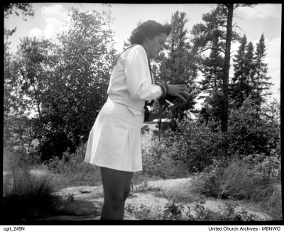 Photographs are a vital part of the collection.  Here a CGIT Leader is photographed taking pictures at  Camp Brereton in the Whiteshell in Manitoba. Date unknown.  UCArchivesWinnipeg cgit 249N