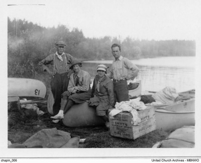 """The Last Portage into Island Lake"", Roccoe and Etta Chapin with travel companions Roscoe Chapin Sr. and Dorinda Stonehouse Sturdy.  UCArchives chapin 06"