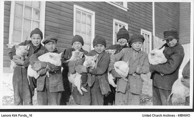 Boys worked on the 1,000 acre farm: grain, dairy, livestock, garden and orchard.  These boys were at the school in 1926-27. UCArchivesWpg kirk161